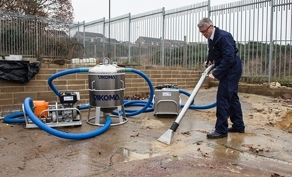 Flood remediation vacuum system